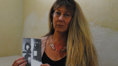 Michelle SBS holding photo of mother