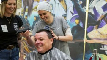 Detectives shave heads for colleague suffering from leukaemia