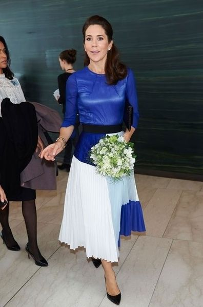 Princess Mary changes her shoes while out with Sweden's Crown Princess Victoria