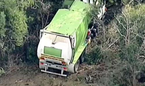The cyclist was killed after colliding with a garbage truck this morning. Picture: 9NEWS