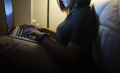 Woman using computer online