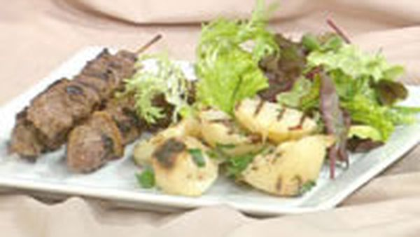 Kangaroo ginger skewers with barbecued potato slices