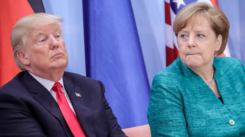 Donald Trump and Angela Merkel at the G20 Summit. (AAP)