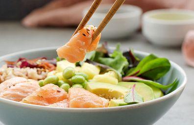 Healthy salmon poke bowl with avocado