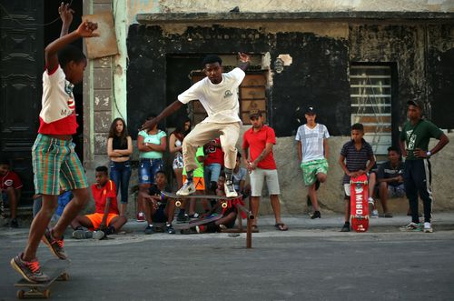 Cuban children play in the street as their country moves to a new leader. (AAP)