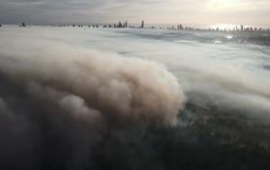 Gold Coast blanketed in thick smoke haze as crews battle grass fire at Carrara