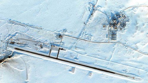 """Russia's northernmost military facility, the airfield in Nagurskoye is one of several """"trefoil"""" bases, featuring a three-ponged building painted in the colors of the Russian flag. Nagurskoye is seen here on March 16."""