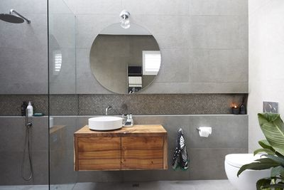 The grey wall tiles draw your eye upwards as they disappear towards the skylight.