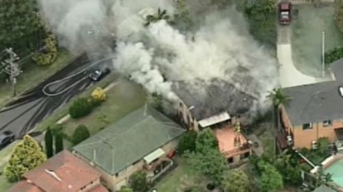 A man has been taken to hospital with burns after a house fire in Castle Hill. (9NEWS)
