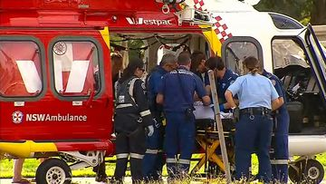 A five-year-old girl has been rushed to hospital after being trapped in a car.