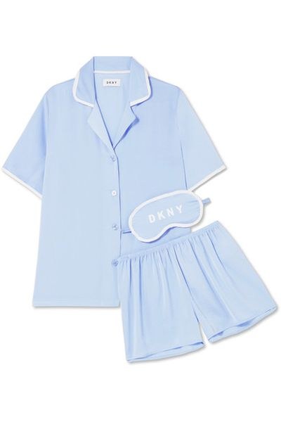 "<em><a href=""https://www.net-a-porter.com/au/en/product/975104/dkny/never-sleeps-washed-satin-pajama-set"" target=""_blank"" draggable=""false"">DKNY Never Sleeps washed-satin pyjama set, $93.96</a></em>"