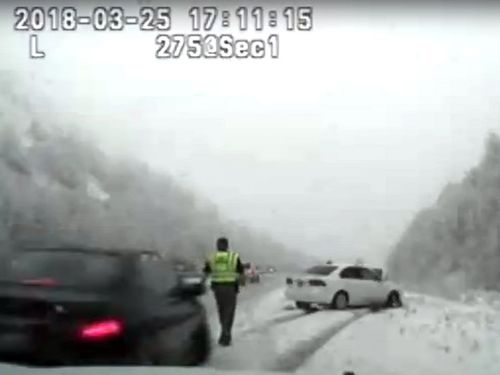 State trooper Cade Brenchley was struck by a car while trying to help another car that appeared to have skidded across the road in Utah.