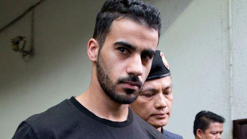Prison guards escort Bahraini football player Hakeem al-Araibi from a court in Bangkok, Thailand.