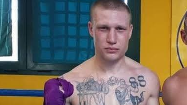 Boxer banned for 'disgusting' tattoos
