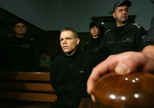 Bulgarian policemen stand guard around Australian Jock Palfreeman before the start of a 2008 hearing of his appeal case in the Court of Appeal in the Bulgarian capital Sofia.