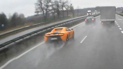 <p>A Polish driver was brought back down to earth after being filmed spinning out and crashing his super car after accelerating in wet weather.</p> <p> The footage, uploaded to YouTube last Friday, shows the driver of the orange McLaren 650S cruising along the main motorway between Krakow and Warsaw when he decided to floor it. </p> <p> But the drizzly conditions caused the man to lose control of his car, a model that sells for just under $450,000, and hitting a road divider and spinning out six times before coming to a halt. </p> <p> It is not known whether the man suffered any injuries or whether it was just his flashy car that was left battered by the costly episode. </p> <p> Check out this gallery for more instances of supercar drivers coming unstuck on the road.</p> <p> </p>