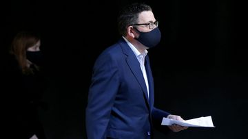 Daniel Andrews wearing a mask ahead of his press conference.