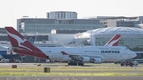 A Qantas aircraft on the tarmac at Sydney Airport, Friday, March 20, 2020.