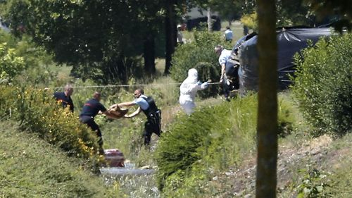 Emergency personnel work at the scene of a suspected Islamist attack in southern France. (AAP)