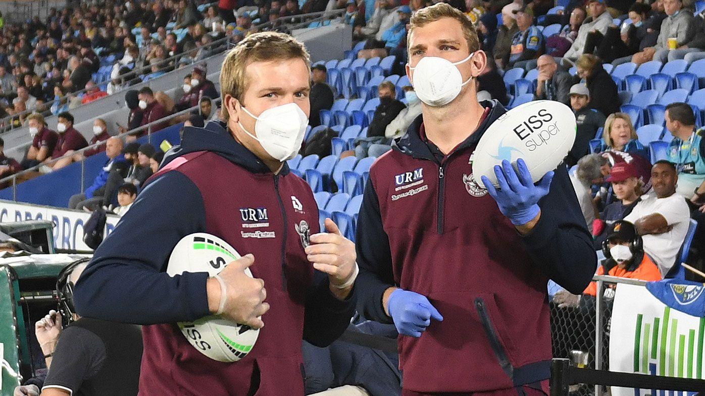 Brothers Jake and Tom Trbojevic act as ball boys during Manly's clash on the weekend.
