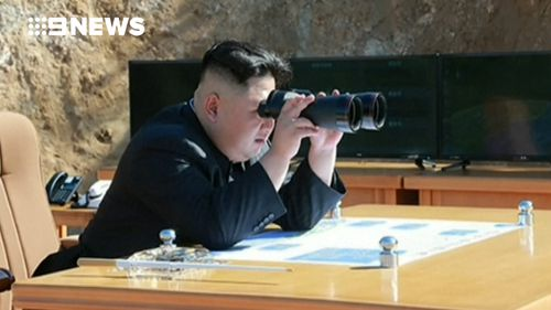 Kim Jong-un watches the missile launch. (Supplied)