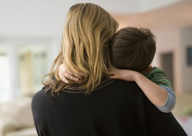 Woman hugging male child