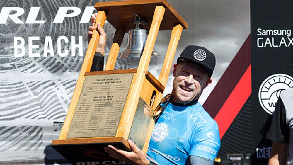 Mick Fanning rings the bell after winning the 2015 Rip Curl Pro. (Getty)