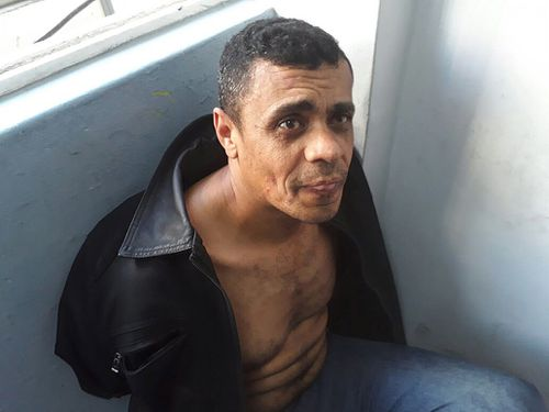 Adelio Bispo de Oliveira, the alleged attacker, in custody.