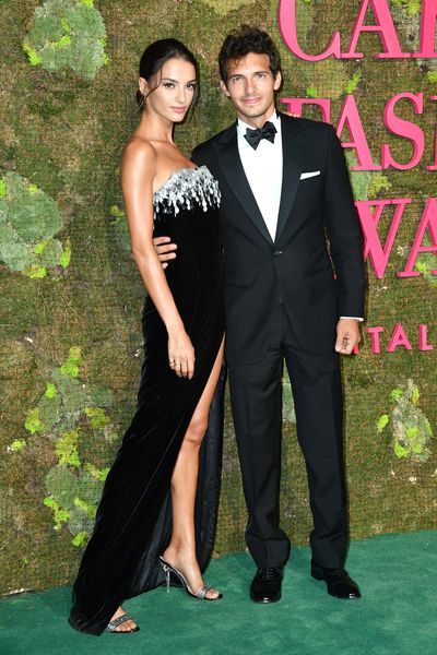 Model Gabrielle Caunesil and partner Riccardo Pozzoli. Gabrielle wears a gown by label Izeta.