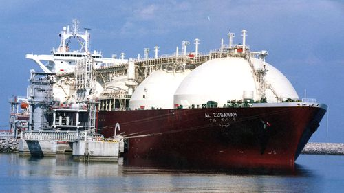 Qatari Liquid Natural Gas (LNG) tanker ship being loaded up with LNG at Raslaffans Sea Port, northern Qatar. (AAP)