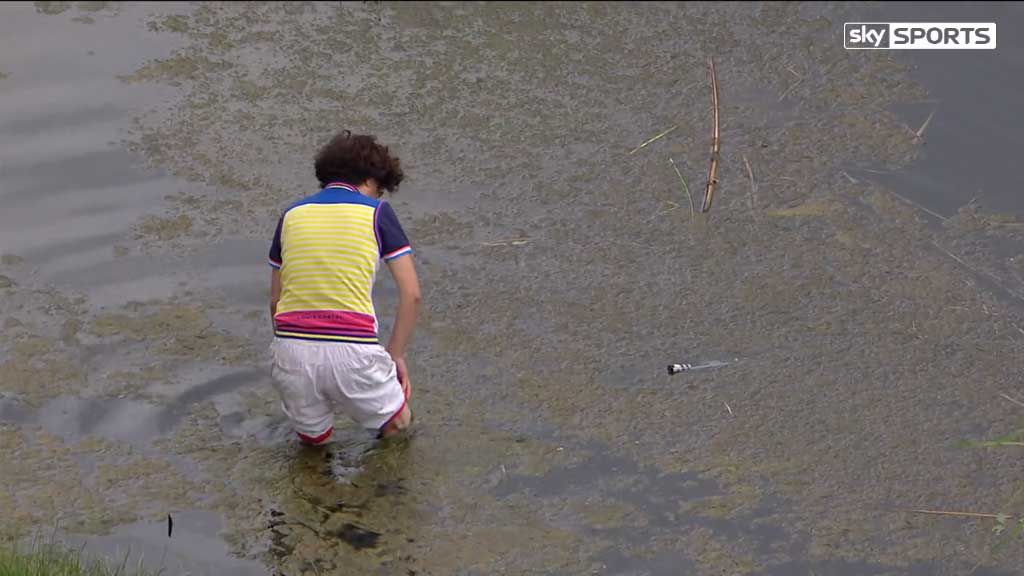 Golfer's mother jumps in water to retrieve club