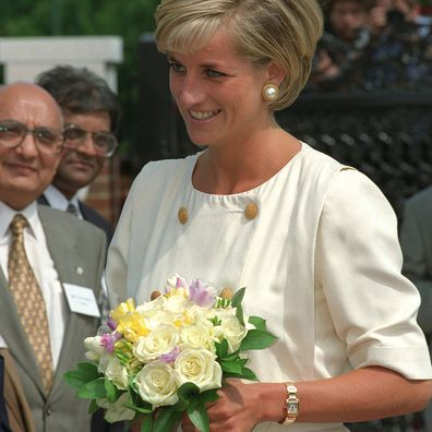 Princess Diana wearing her gold Cartier Tank Francaise watch in 1997.