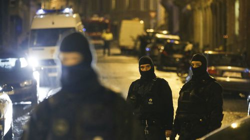 Heavily-armed special forces police remain at the scene in Verviers as well as carrying out new raids across the country. (AP)
