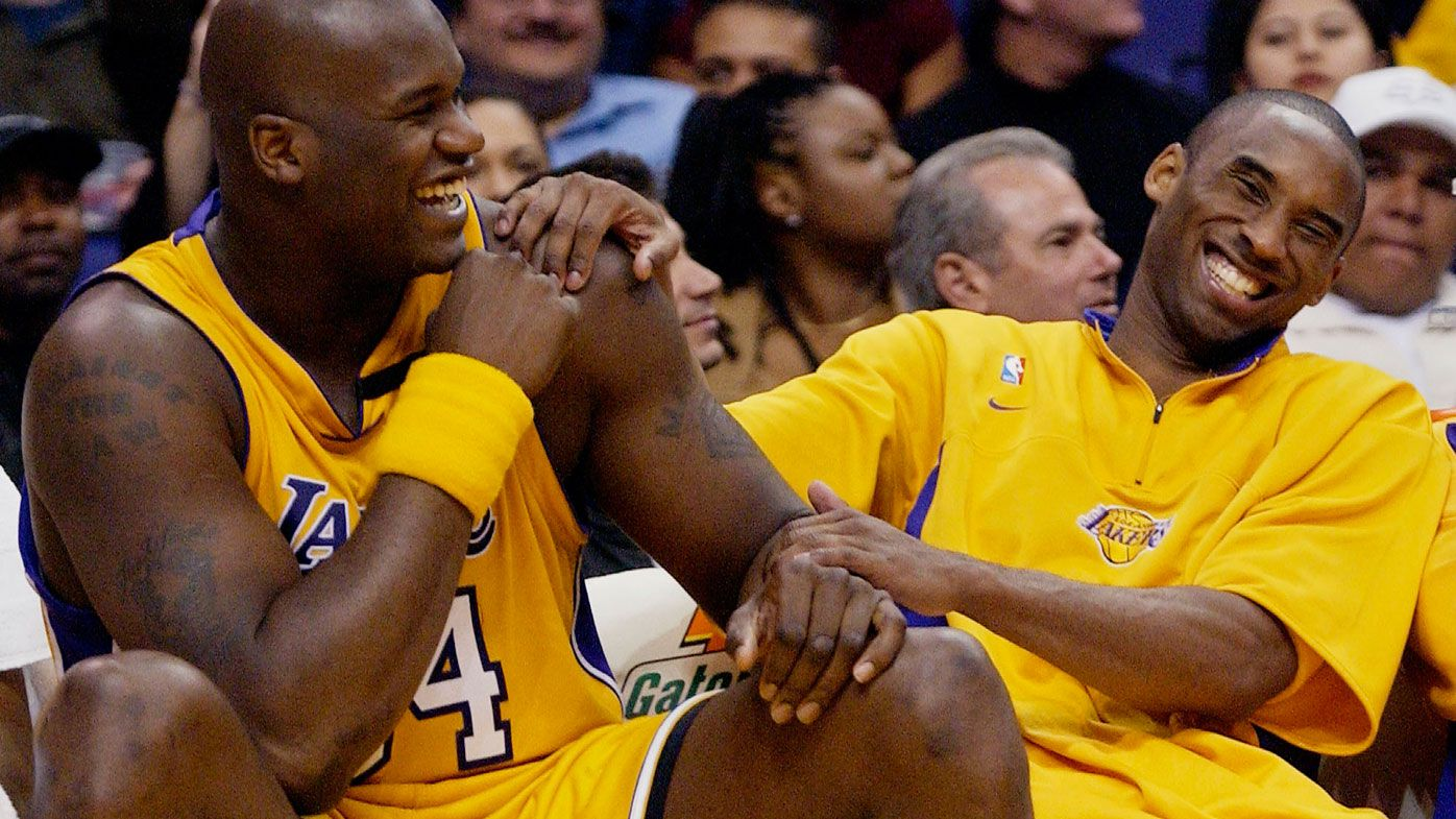 In this April 15, 2003, file photo, Los Angeles Lakers Shaquille O'Neal, left, and Kobe Bryant share a laugh on the bench