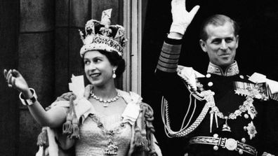 Queen Elizabeth II  and Prince Philip wave to the crowd after her Coronation