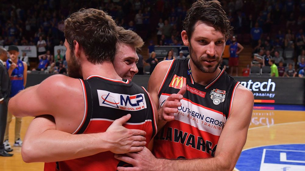 Mitch Norton, Rotnei Clarke and Kevin White celebrate the win. (Getty Images)