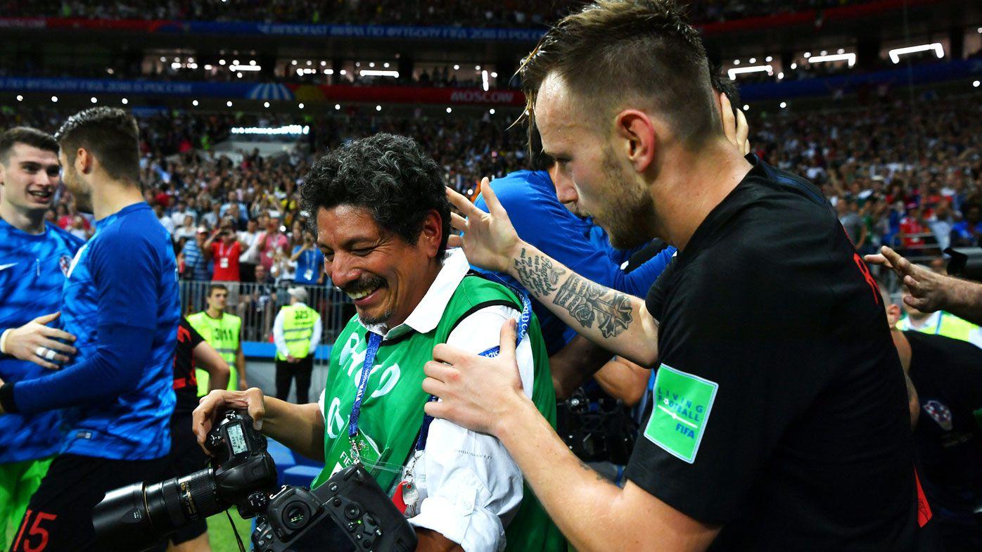 AFP photographer Yuri Cortez is comforted by Croatian player Ivan Rakitic.