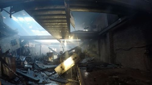 The fire completely destroyed the inside of the building. (9NEWS)