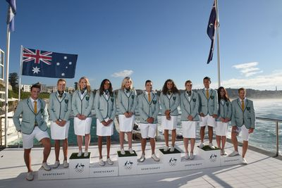 The uniforms, which the team will wear during the opening ceremony in Rio, features a green and white striped jacket with white bottoms and shoes.
