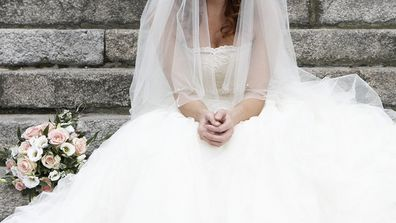 Bride sad sitting on steps