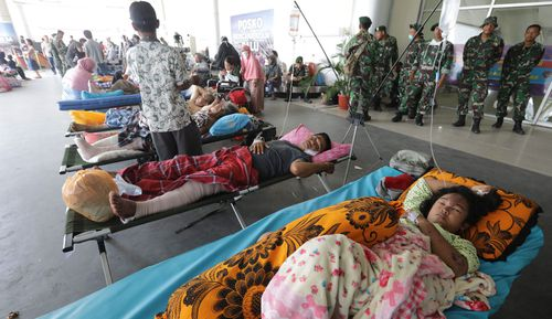 Locals sleeping at Palu airport in the earthquake-hit city.