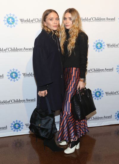Mary-Kate and Ashley Olsen at the 2014 World Of Children Awards in New York, both wearing their label The Row, in November, 2014