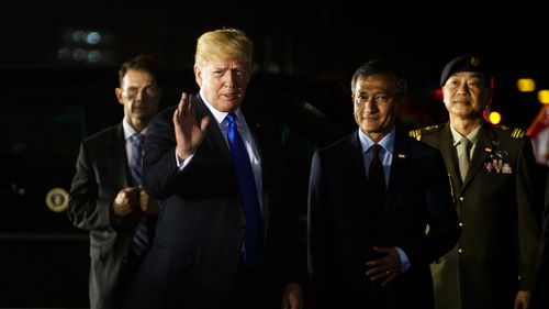 The US President's trade adviser fired off the anti-Trudeau message as Donald Trump arrived in Singapore for his summit with Kim Jong Un of North Korea. Picture: AP