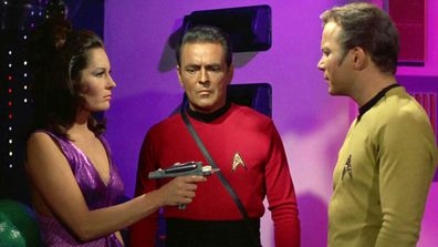 "Marj Dusay as Kara, James Doohan as Montgomery ""Scotty"" Scott and William Shatner as Captain James T. Kirk in the Star Trek."