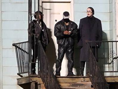 From left to right: DaBaby, Kanye West and Marilyn Manson during the Donda event on August 26, 2021 in Chicago, Illinois.