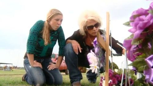 Sandy and Saige at the grave.