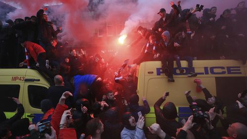 A Liverpool fan was left in a critical condition before the club's Champions League semi-final match with Roma after a mass brawl broke out. Picture: AAP.