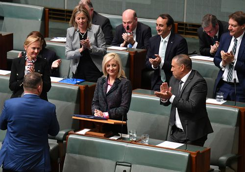 Liberal Member for Lindsay Melissa McIntosh is applauded after making her maiden speech in the House of Representatives at Parliament House in Canberra.
