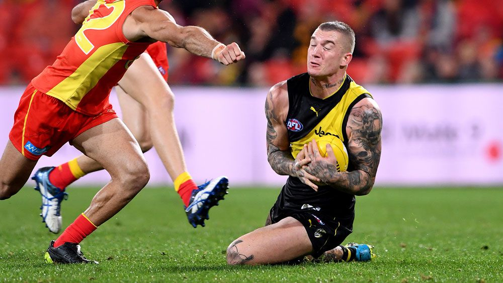 Tigers grind past injury-hit Suns in AFL