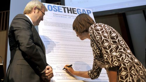 Prime Minister Kevin Rudd and Health minister Nicola Roxon sign the statement of intent at the Closing the Gap launch in Canberra in 2008.